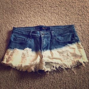 Pants - Distressed denim booty shorts